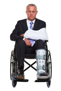10058823 - an injured businessman sitting in a wheelchair, isolated against a white background.