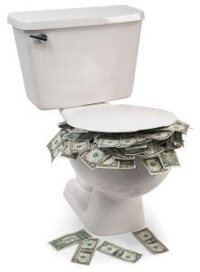 7049258_ml-money-down-toilet